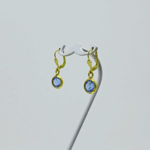 Gold-plated earrings with light blue stone