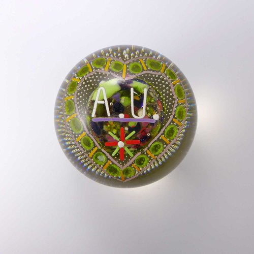 Glass paperweight with monogram A.U.