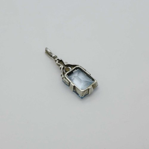 Art Deco pendant with light blue stone