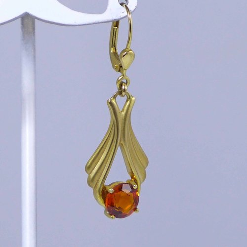 Gold earrings with topazes in cognac brown